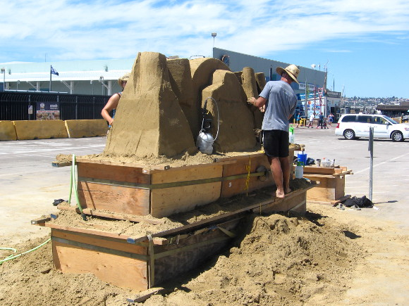 Sand sculpture is prepared in front of San Diego's Cruise Ship Terminal.