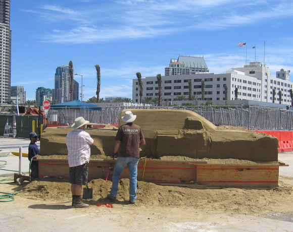 These guys are working on a life-sized sand truck!