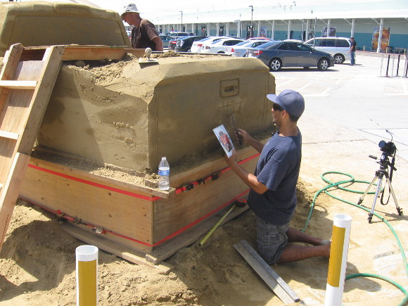 Carefully adding Chevrolet logo to back of the detailed sculpture.
