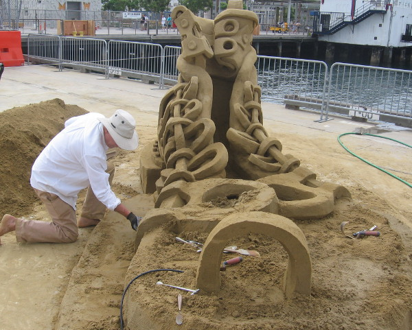 The master sand artists all work very carefully as big festival begins.