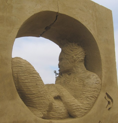 A close photo of some very fine work by a sand sculpting master.