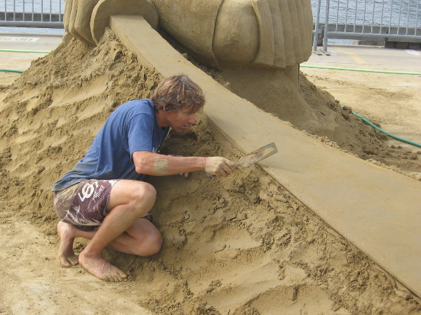 Chris Guinto concentrates as he carefully smooths an edge on his sculpture.