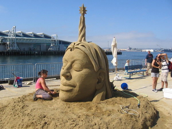 Visible are the Broadway Pier and a few visitors to the US Sand Sculpting Challenge.