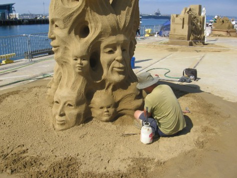 The world masters' sand sculptures are lined up alongside San Diego Bay.