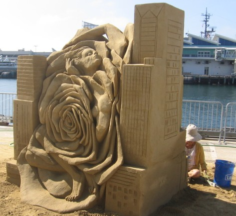 A huge sand rose and human form emerge on the other side!