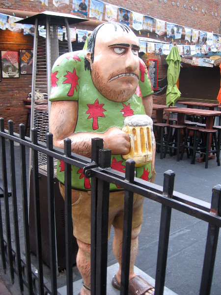 A very dour, funny unshaven dude with beer mug.