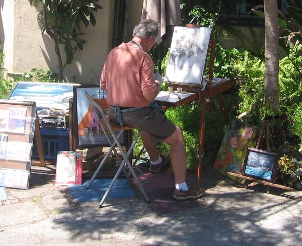 Artist at work outside one studio in Balboa Park's Spanish Village.