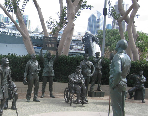 Bob Hope entertains troops by USS Midway Mueum and Unconditional Surrender statue.