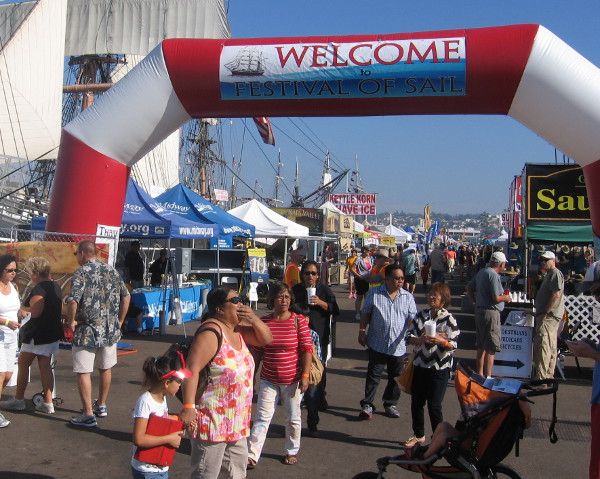 People arrive at San Diego's 2014 Festival of Sail on the Embarcadero.