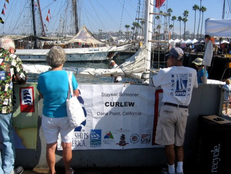 People prepare to board the small staysail schooner Curlew