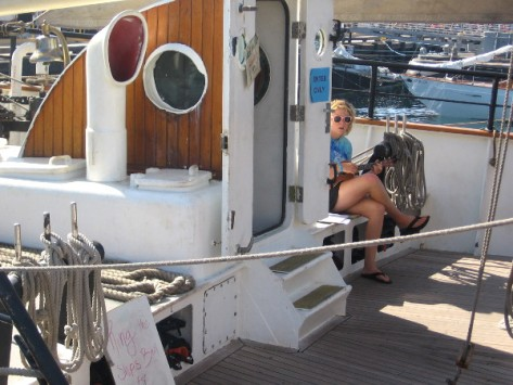 A couple young ladies on board were playing musical instruments for visitors.