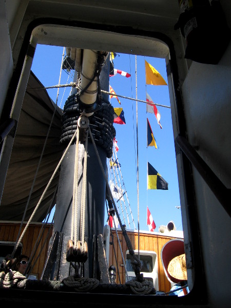 Coming up from below. Flags flap in the sunshine.