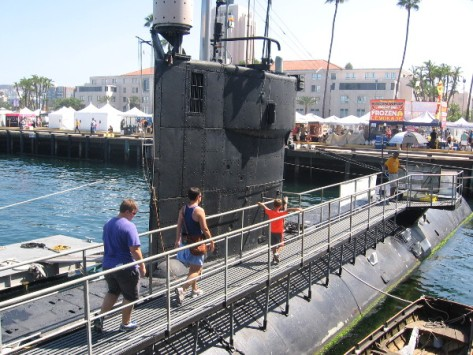 People walk out on the Dolphin, the world's deepest diving submarine.