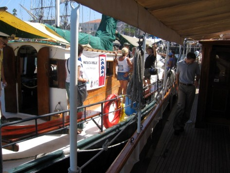 The small Patricia Belle, from Mexico, is tied up next to the steam yacht Medea.
