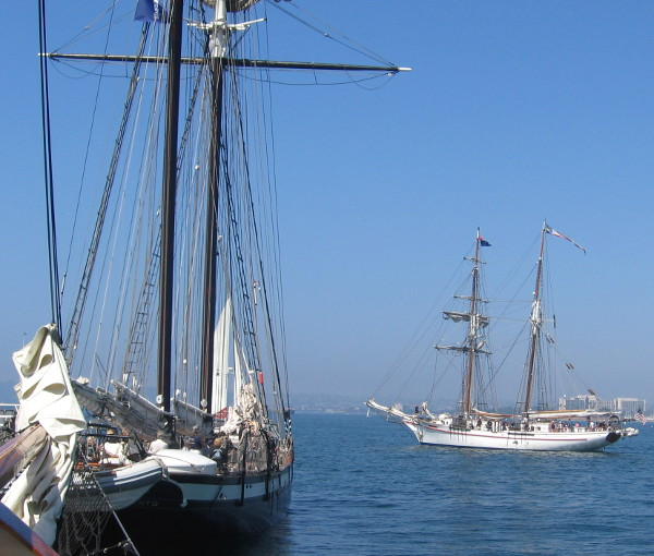 The Exy Johnson sails out to be followed by the Californian, in the foreground.