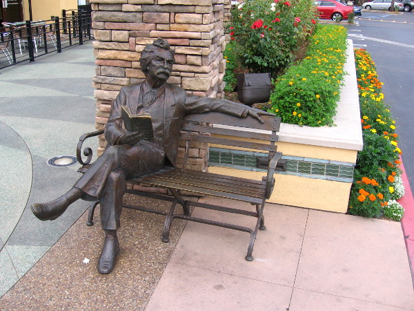Sculpture of Mark Twain sitting on a bench at Fenton Marketplace in Mission Valley.