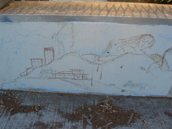 Sketch of female face and buildings on Sixth Avenue bridge above Interstate 5.