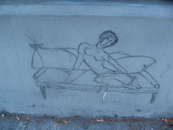 Stylish figure on couch with vase seems the work of a practiced artist.