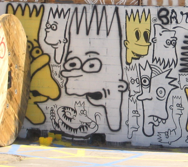 Crazy, creative, funny drawings of Bart Simpson on a wall.