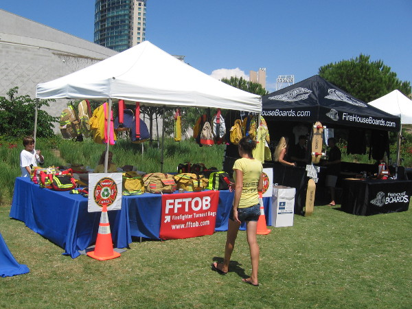 Used firefighter turnout bags and skateboards sold in front of Hilton.