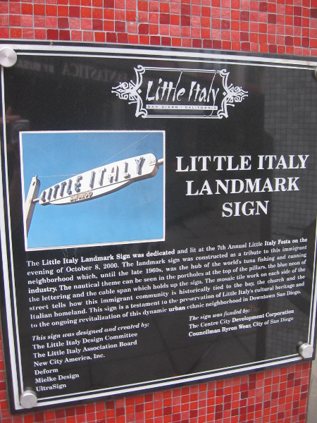 Plaque explains the history of the Little Italy Landmark Sign.