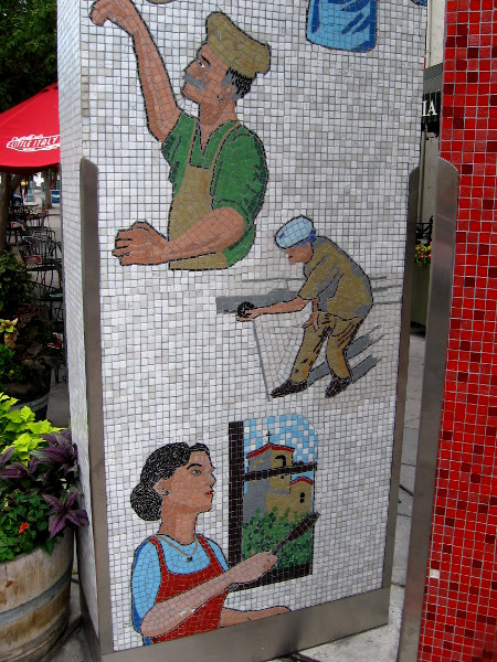 Mosaic tiles show the community's ties to Italy and traditions.