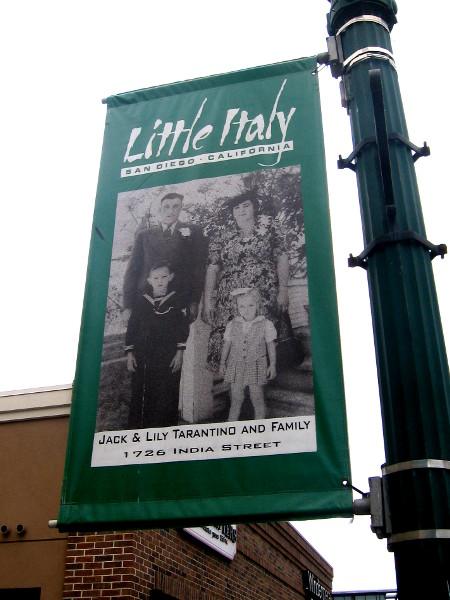 Banner on street lamp shows Tarantino family.