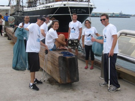 Volunteers help clean up San Diego Bay near the Star of India.