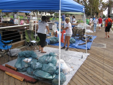 Bags of trash are collected as the morning progresses.