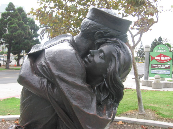 Love and thankfulness depicted on face of a Navy wife.