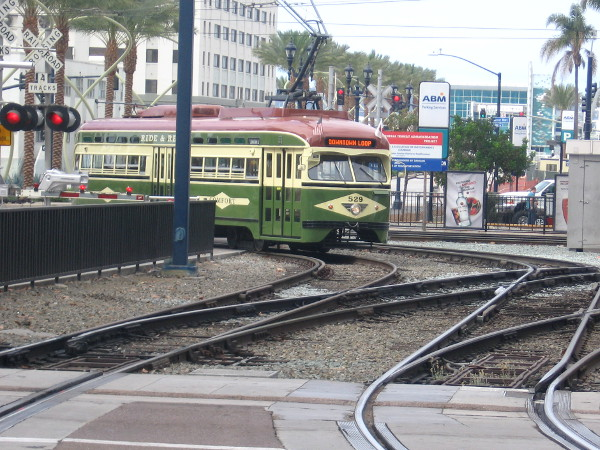 Here comes the San Diego Trolley's cool Silver Line, approaching America Plaza!