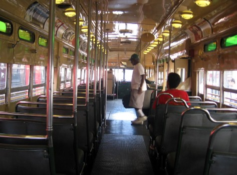 Another passenger steps onto the restored trolley at the Fifth Avenue station.