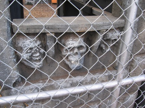 Close look at skulls embedded in the castle-like entrance.