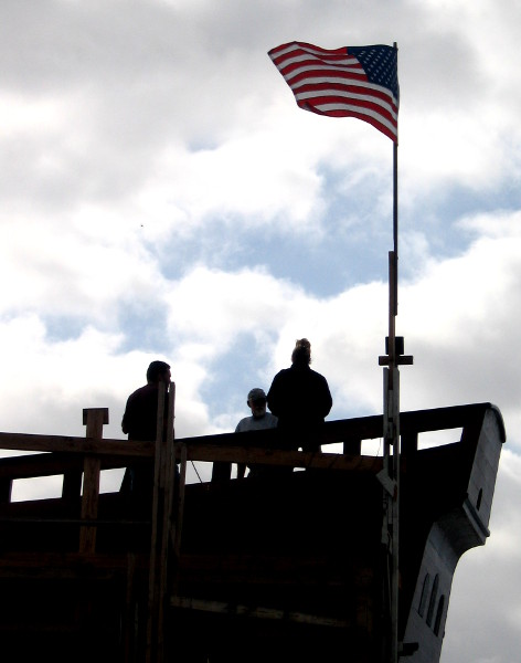 People on the upper deck of the almost finished galleon.