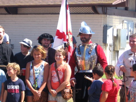 Kids pose with a modern day version of Juan Rodriguez Cabrillo.
