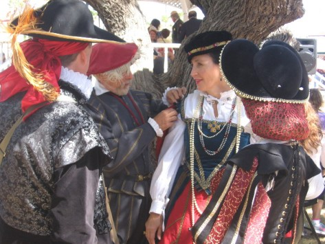 Making an adjustment to costume from the Old World centuries ago.