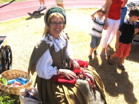 Friendly lady was making woolen caps to be worn under those heavy steel helmets!