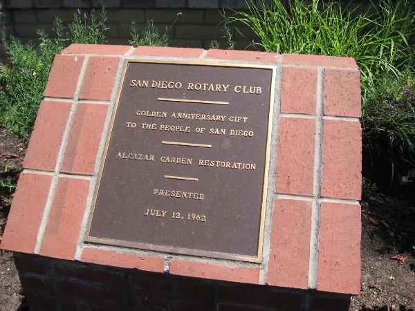 Rotary Club plaque reveals that the garden underwent a restoration.