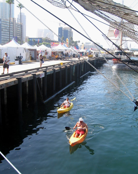 Kayakers were out cruising among the assembled tall ships.