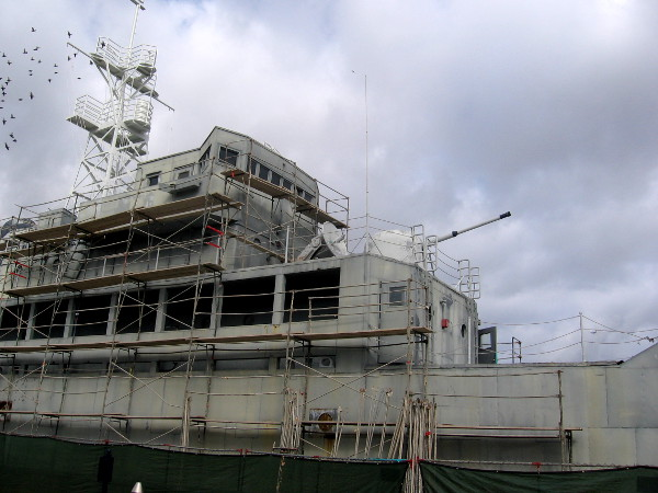 Scaffolding along the side of the weathered old USS Recruit in Point Loma.