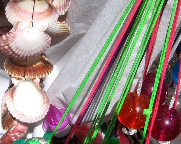 Shells and dangling ornaments for sale on small vendor's cart near the Midway.