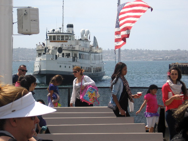 The Lord Hornblower approaches as people disembark from Coronado ferry.