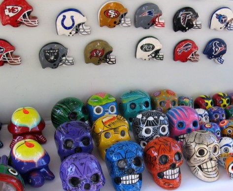 Combination of football helmets and skulls on display for passing tourists.