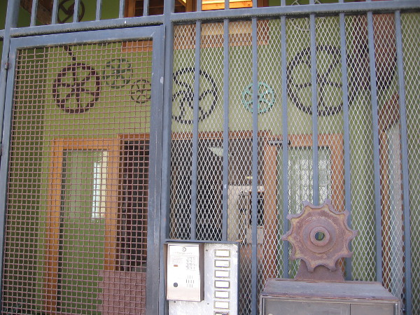 Very cool door with lots of cogs and gears around it.