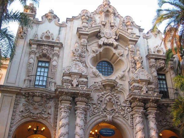 Casa del Prado facade photographed as evening approaches and lights turn on.