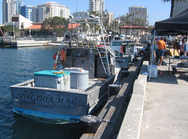 Fishing boats docked at pier where fresh fish are sold every Saturday.