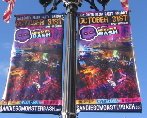 Gaslamp banners advertise a monster bash block party.
