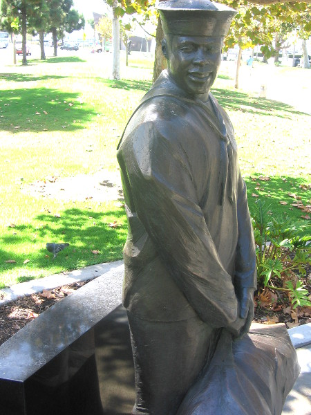 Sculpture of a sailor who served aboard a flattop.