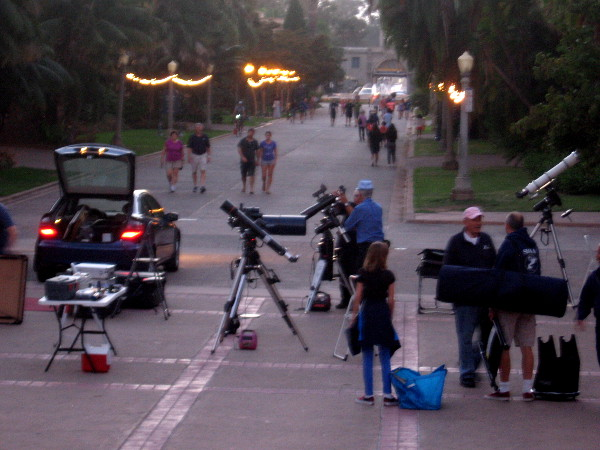 Lights come on along El Prado and more stargazing enthusiasts arrive.