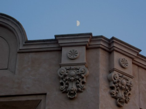 My little camera barely registers the moon above the Reuben H. Fleet Science Center.